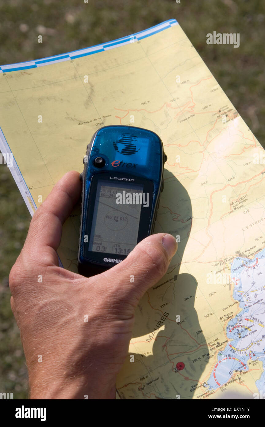 GPS navigation orientation device appliance map map card play cards hiking traveling hand - Stock Image