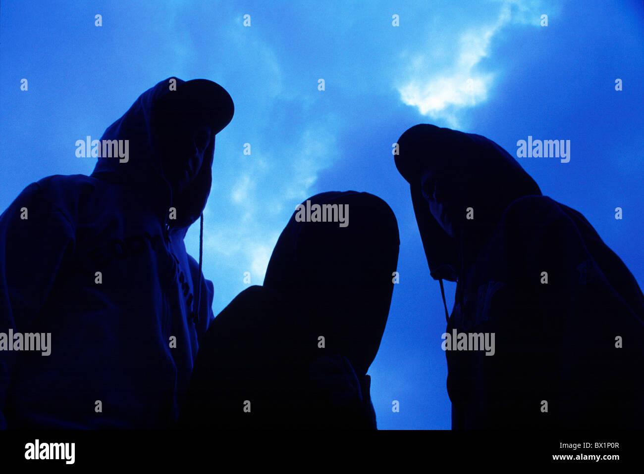 anonymously Boy limited boys darkly dusk Hip-hop hoods Lifestyle portraits teenagers three boys twilight - Stock Image