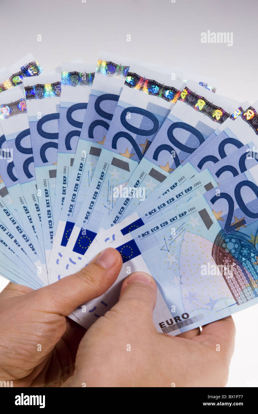 Euro Euro 20 bank notes bills notes bank notes currency finance figures Europe Cash money hands studio - Stock Image