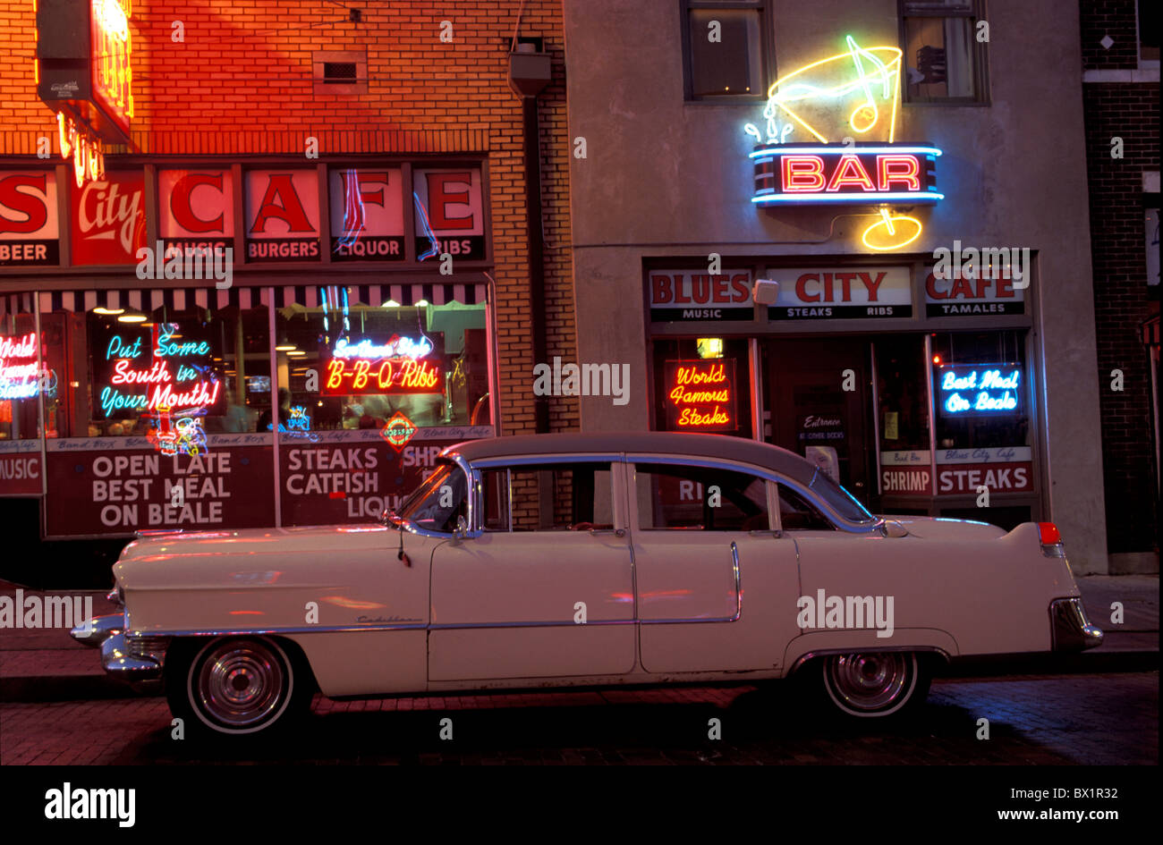 advertisements vintage car at night automobile Beale Street cafe car Classic Car Memphis neon night old t - Stock Image
