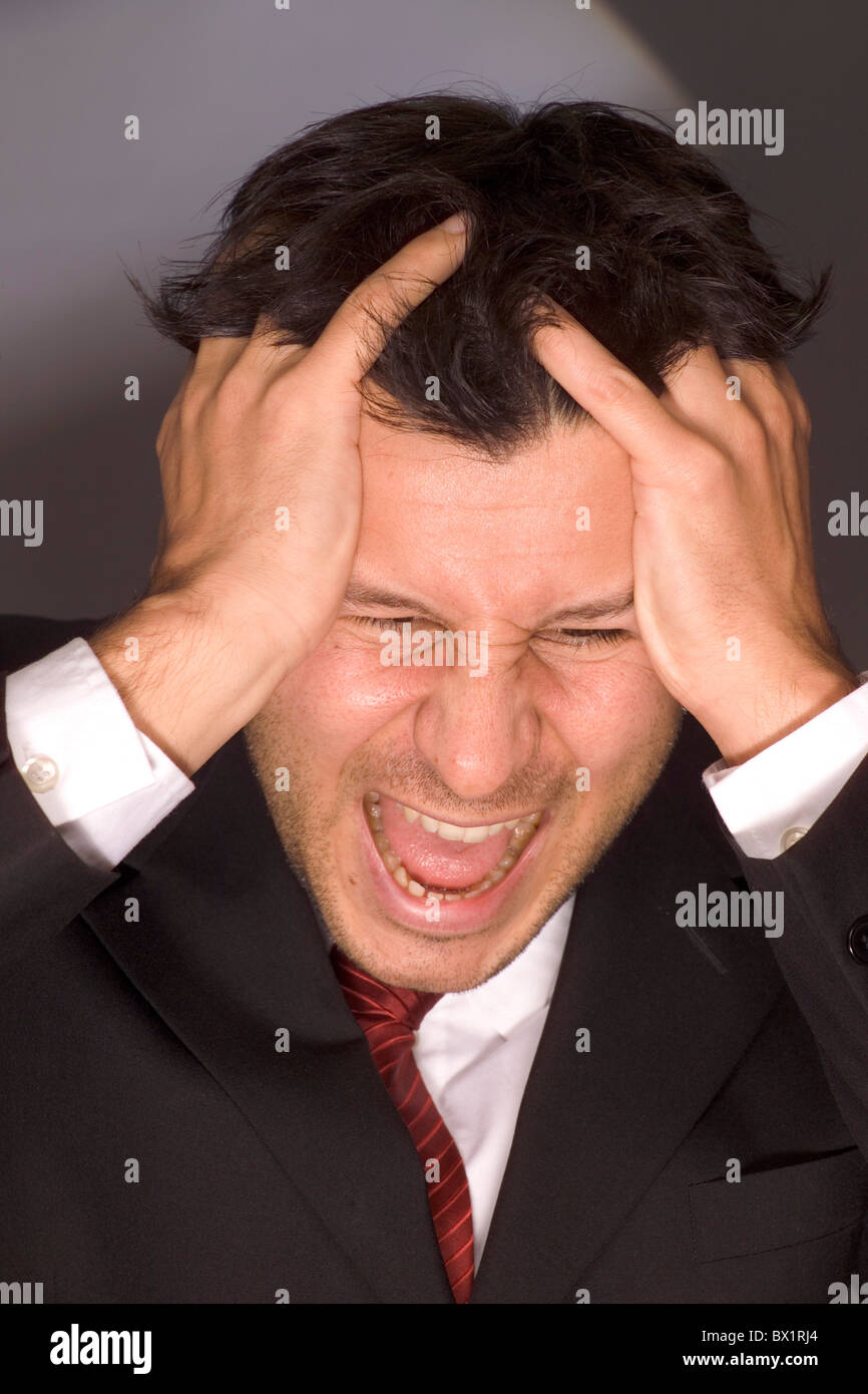 annoy loss Business businessman defeat despair desperation furiously fury gesture man manager portrait p - Stock Image