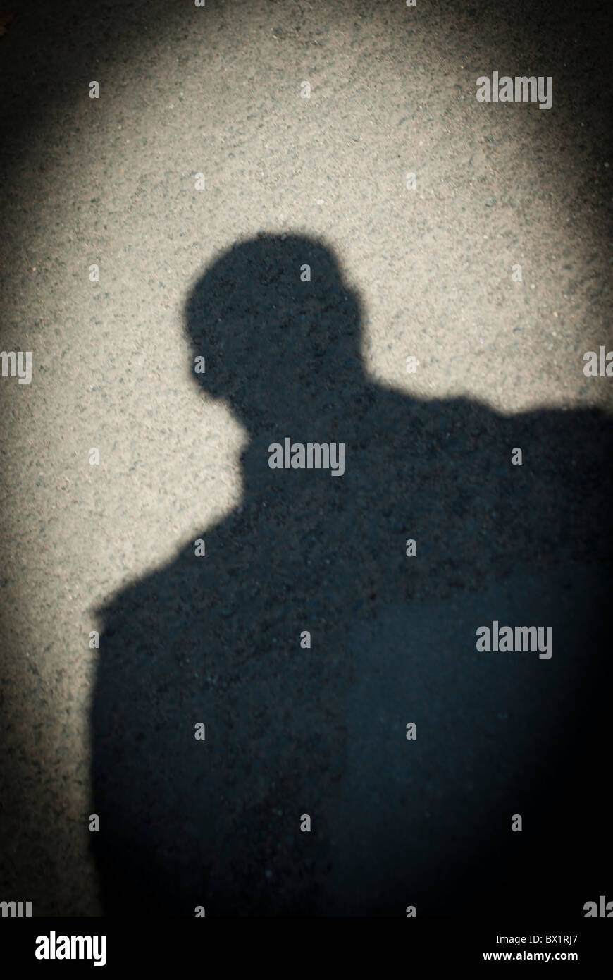 Shadow of a sinister man - Stock Image