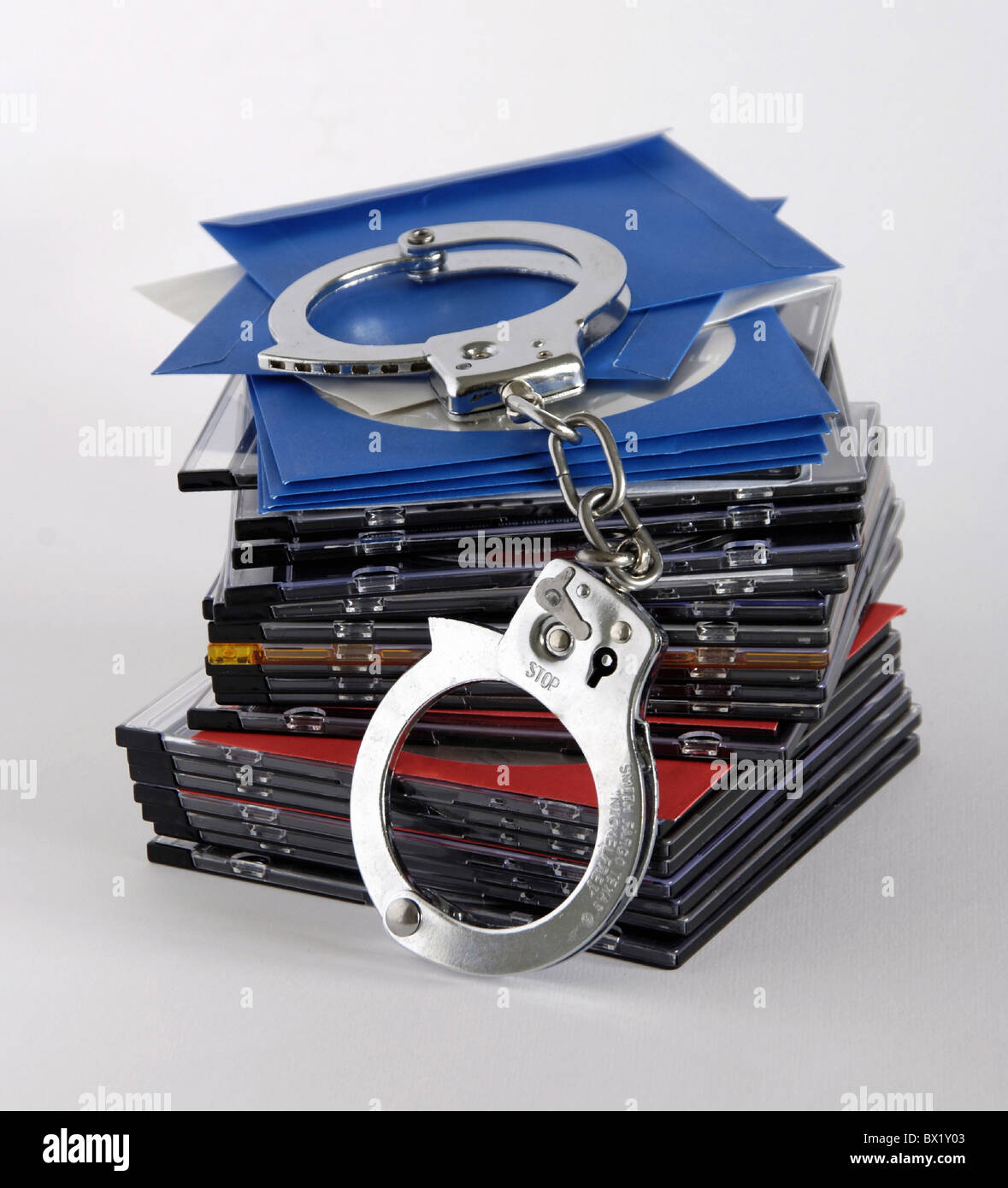 CD DVD robbery copies software pirates handcuffs theft abuse crime computer EDP Electronic Data Procession - Stock Image