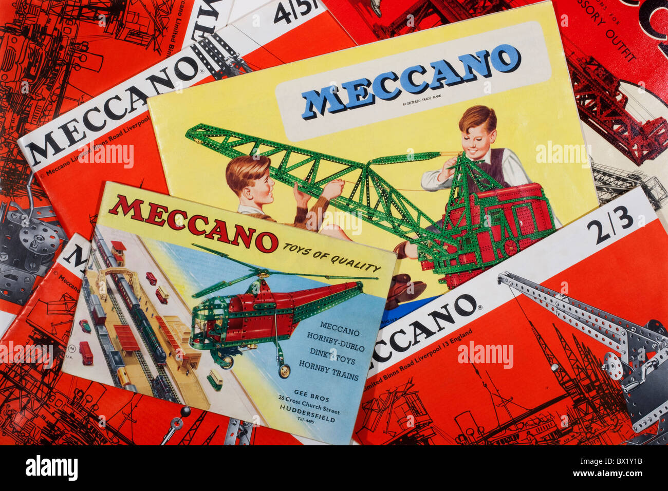 Meccano instruction and accesory outfit booklets used to build working models and mechanical devices invented by Stock Photo