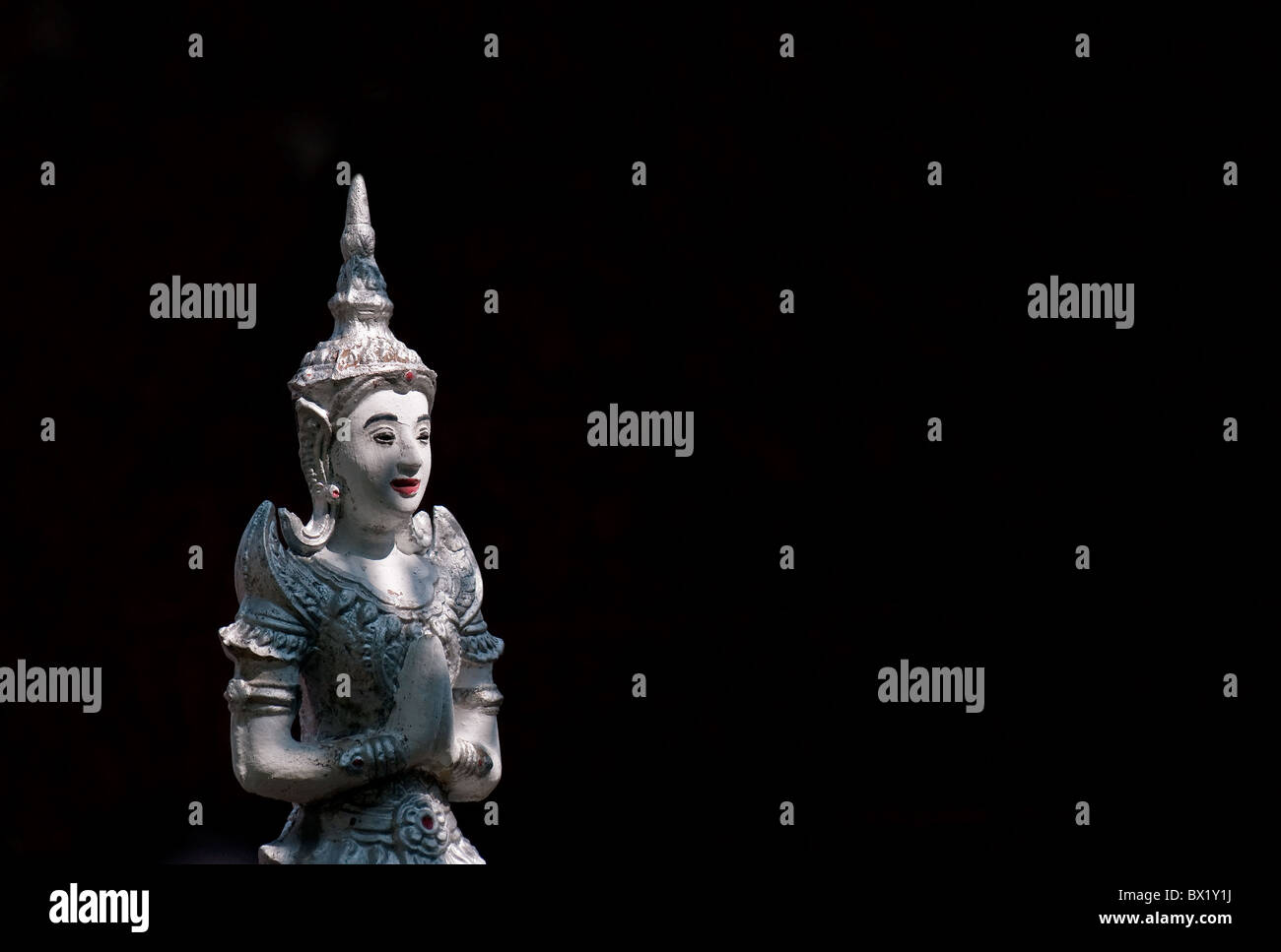 A statue at the Wat Buppharam in Chiang Mai in Thailand. Stock Photo