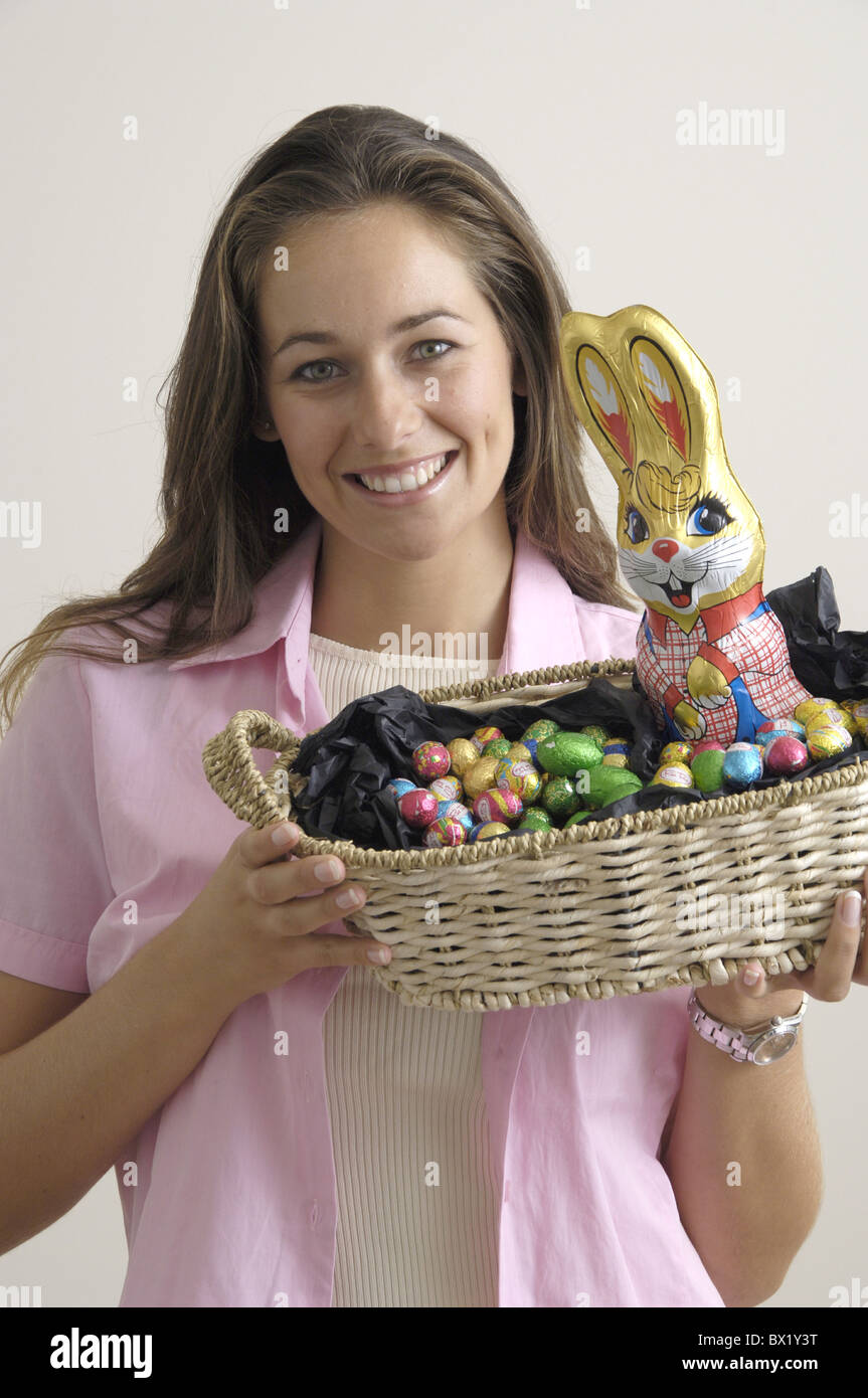 Easter woman joy best wishes eggs present treat basket Easter bunny - Stock Image