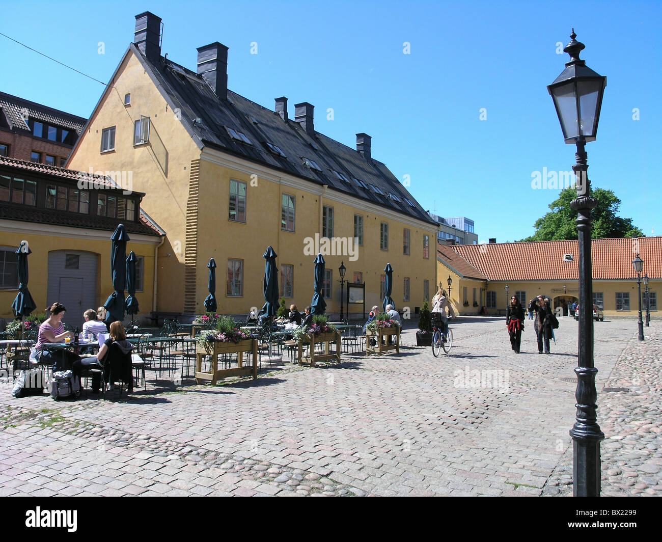 cafe company guests lanterns lives outside people street cafe Sweden Europe - Stock Image