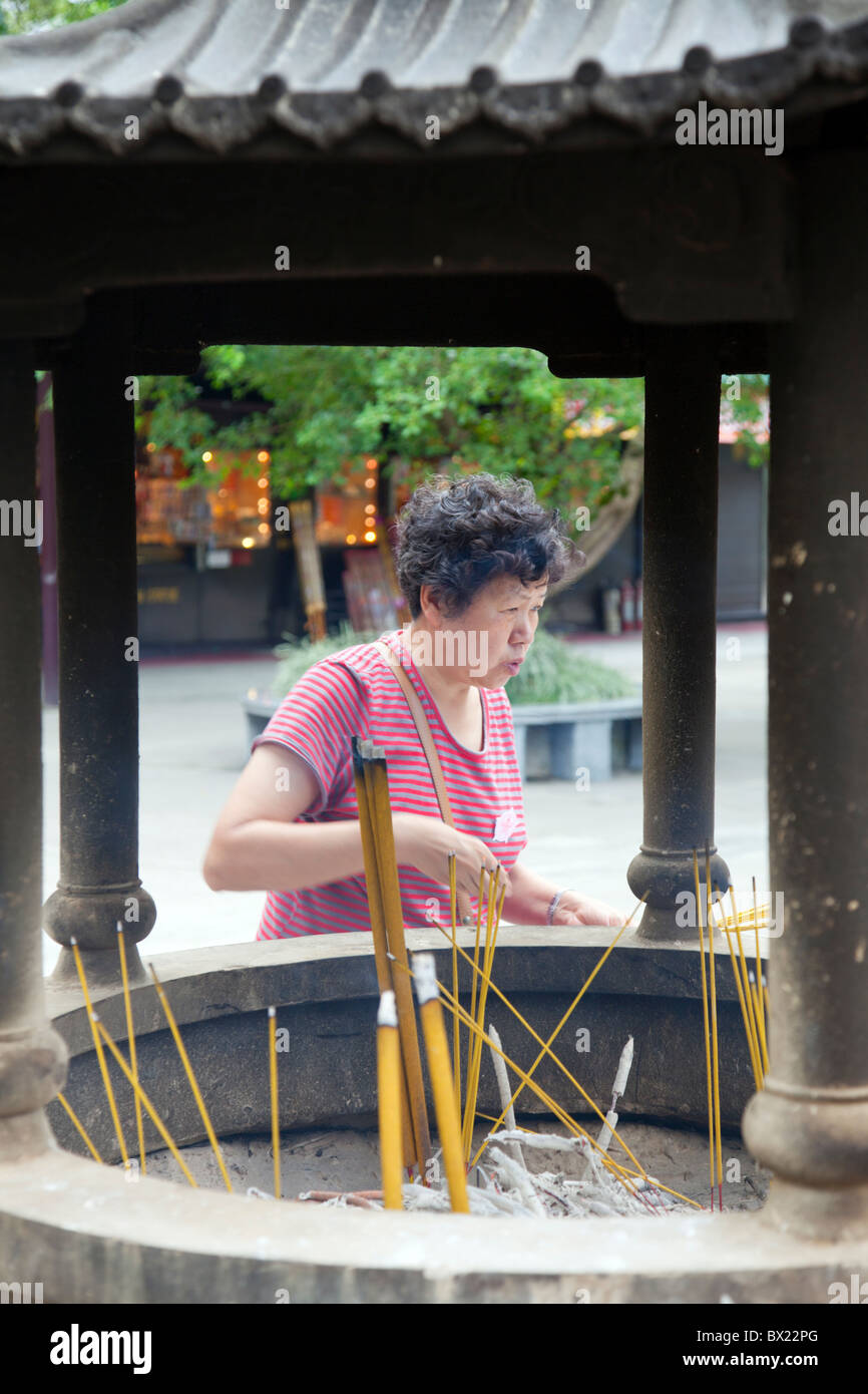 Incense burning at the entrance to Po Lin Monastery - Stock Image
