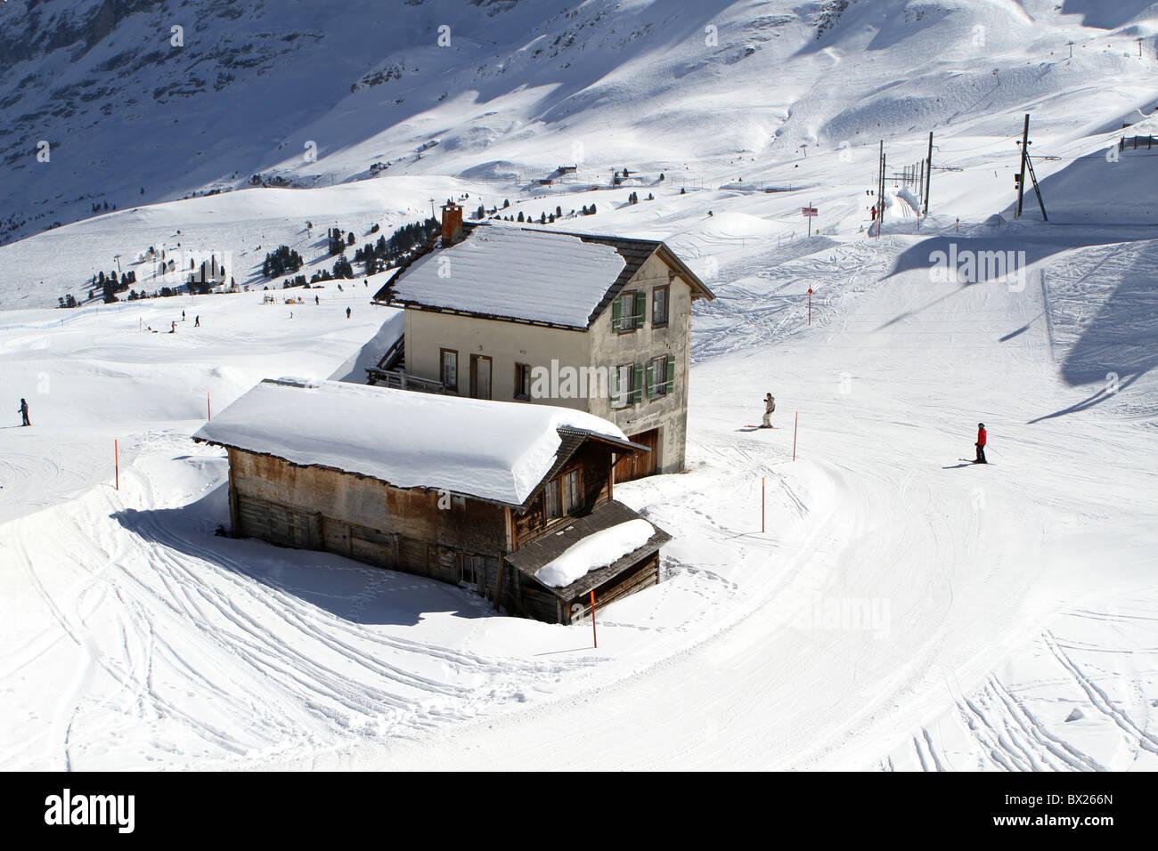 Skiers and chalets at Kleine Scheidegg, Switzerland - Stock Image