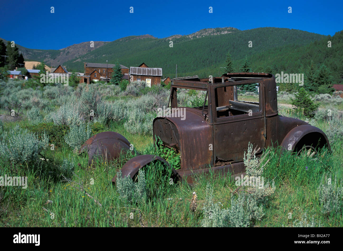 ghost town wreck scrap vehicle scrap metal rubbish settlement Elkhorn Ghost Town State monument monument Montana - Stock Image
