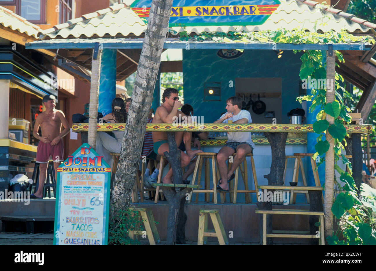Runable aground Bar guests company tourists tourism holidays vacation catering Punta Cana Dominican Republic - Stock Image
