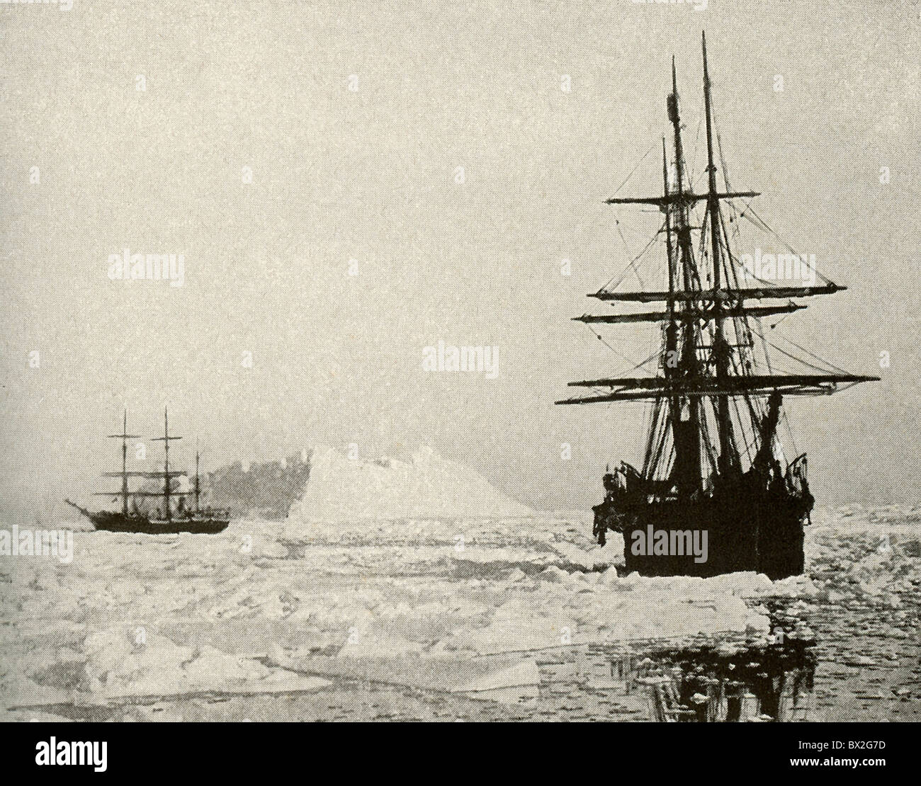Two steam vessels, surrounded by ice floes, hunt seals in Baffin Bay, in North Atlantic, between Baffin Island and - Stock Image