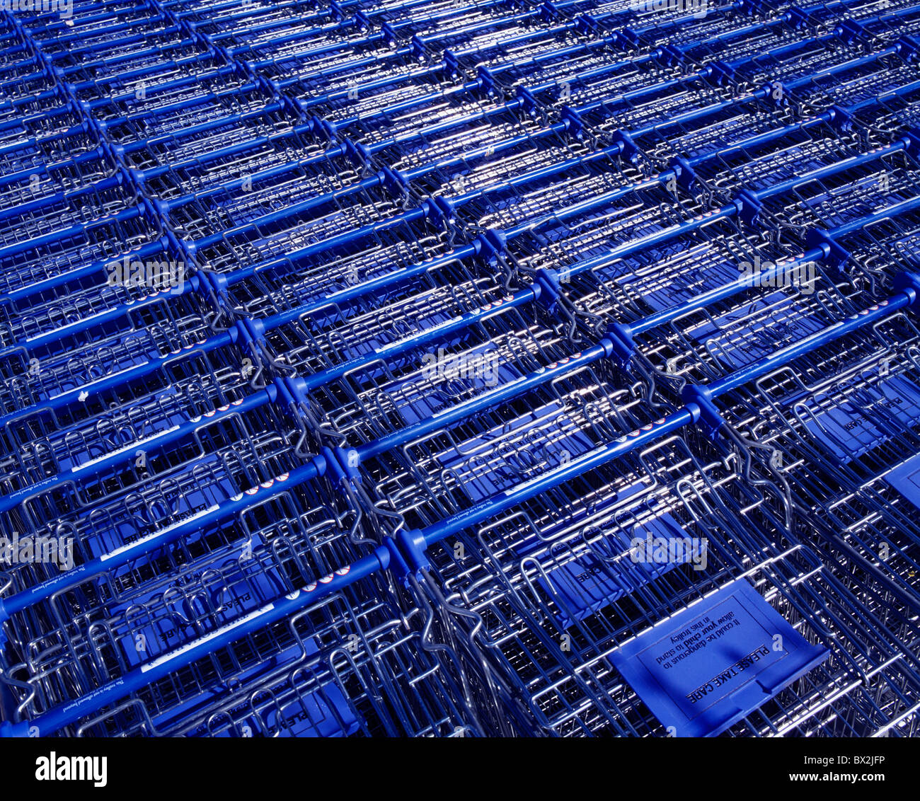 Retail Outlets, Shopping Trolleys, - Stock Image