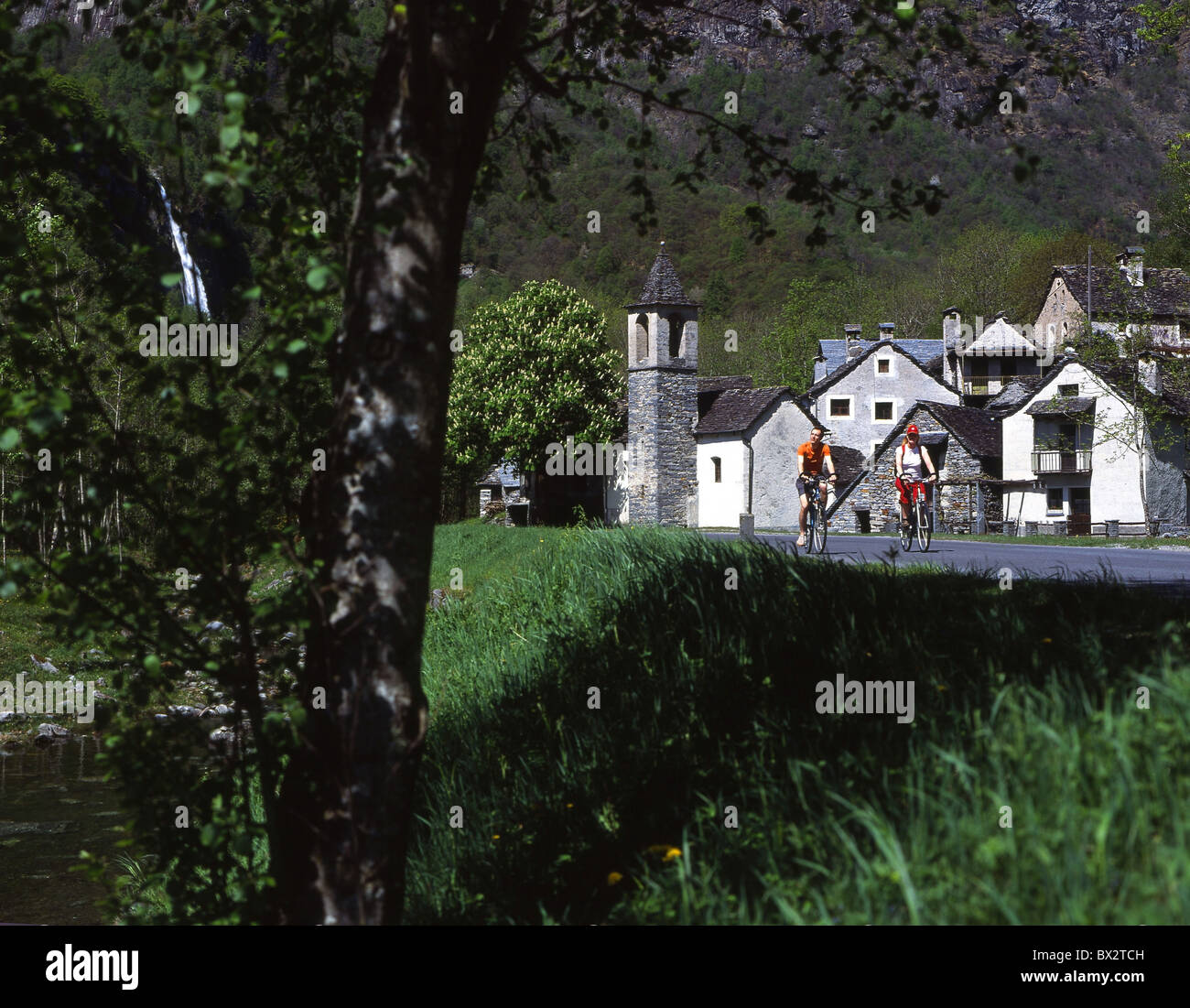 village Ritorto Val Bavona biking couple bicycle bike excursion Canton Ticino Switzerland Europe - Stock Image