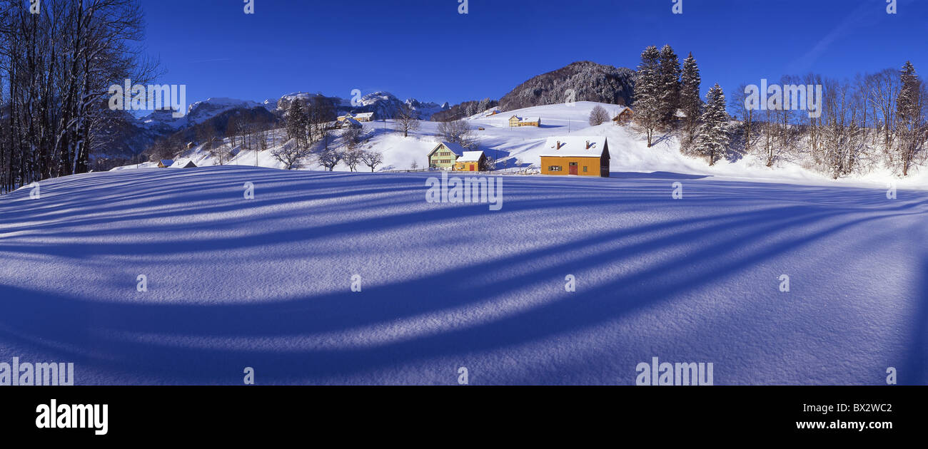 Appenzellerland field farm courts near Weissbad mountains snow winter scenery landscape snow-covered winter - Stock Image