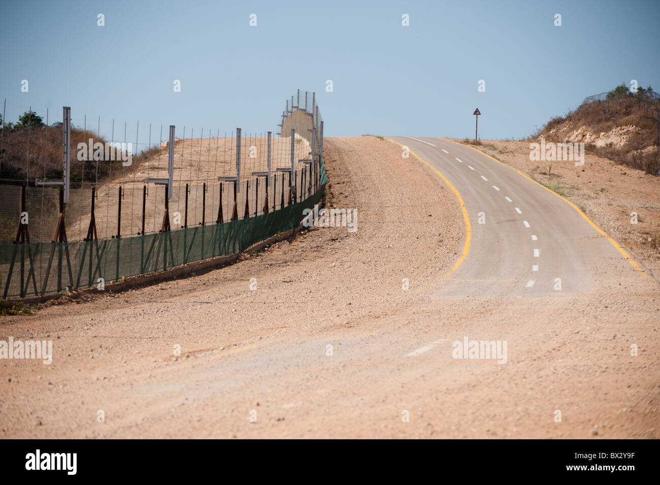 A section of the Israeli separation barrier--here, a fence with sensors to detect tampering. - Stock Image
