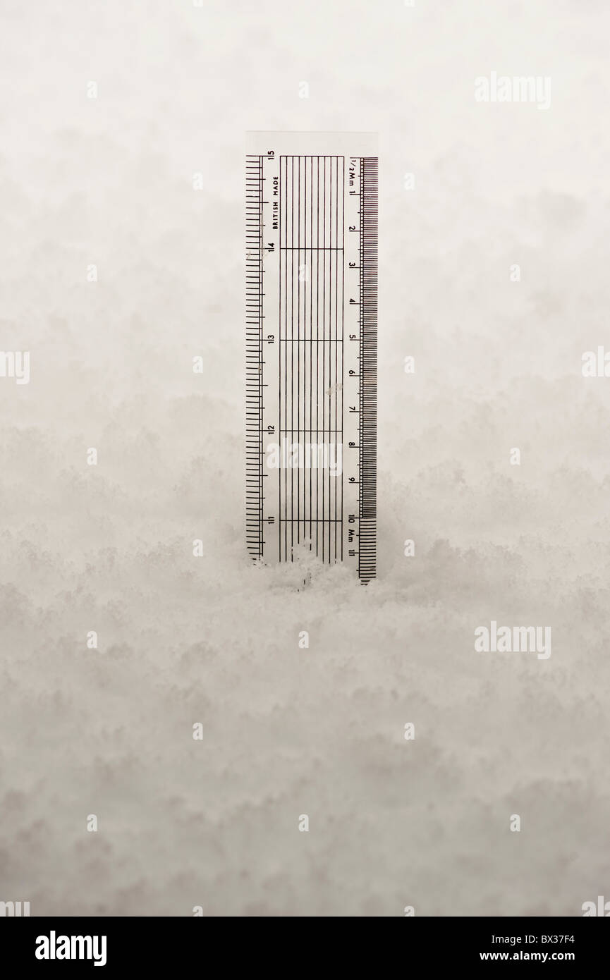 Ruler showing depth of snow 10 inches - Stock Image
