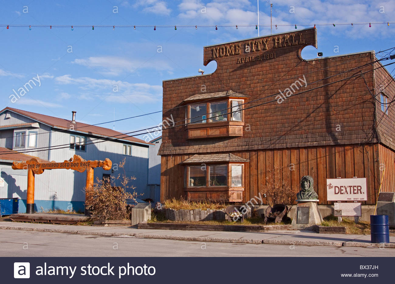 Alaska; Nome City Hall Building, built in 1901. The bronze bust of Ronald Amadsen honors him as the first to travel - Stock Image