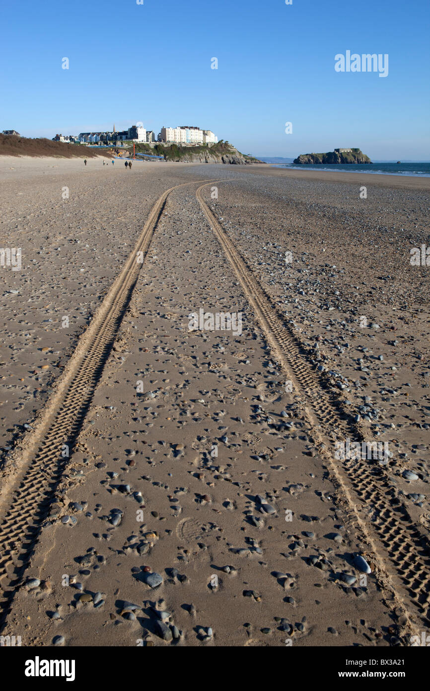 Tyre tracks on Tenby beach - Stock Image