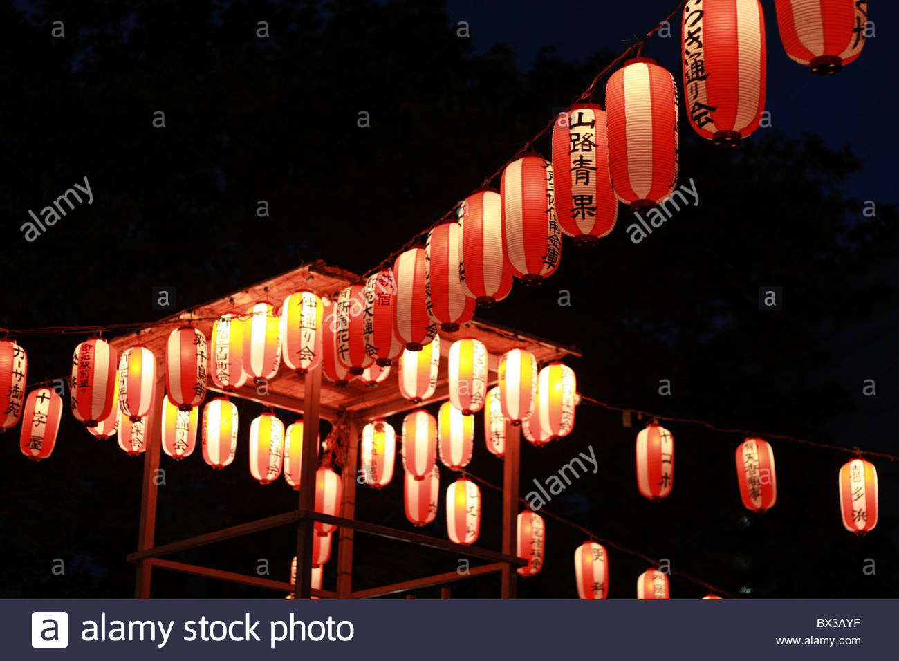 Japanese lanterns light up the night during a summer festival in Tokyo. Stock Photo