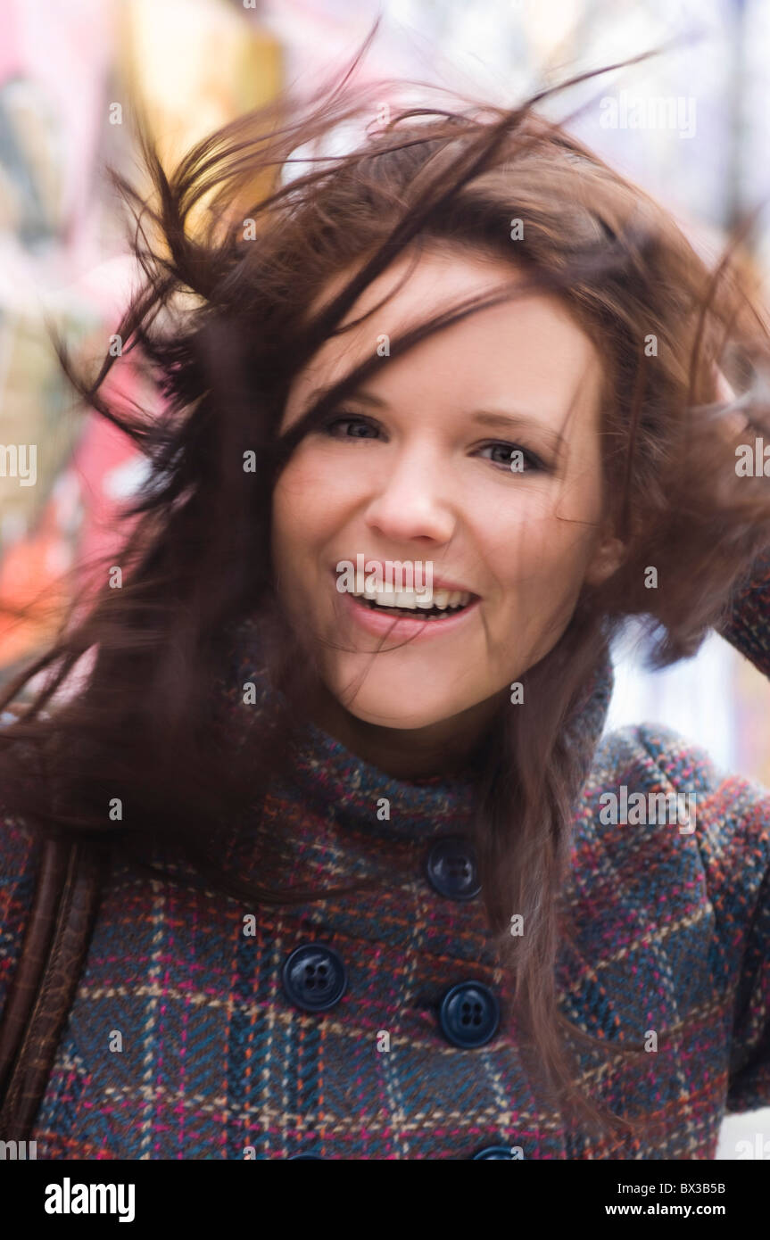 portrait of young woman with windswept hair - Stock Image