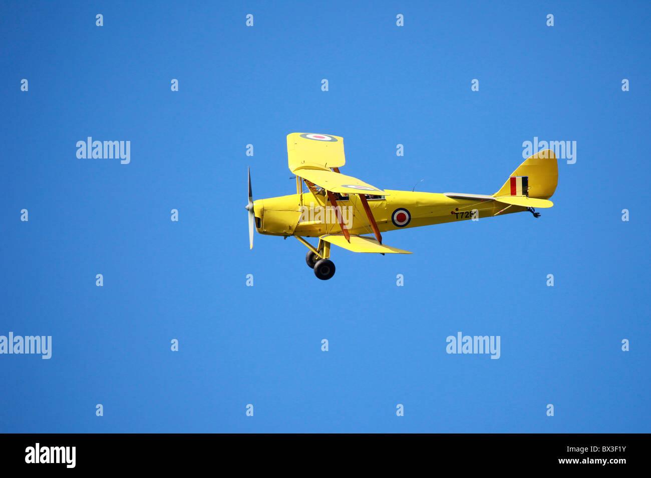 Chipmunk T 7281 in Flight _ De Havilland DH.82A Tiger Moth, G-ARTL / T7281, Private yellow bi-plane, UK - Stock Image