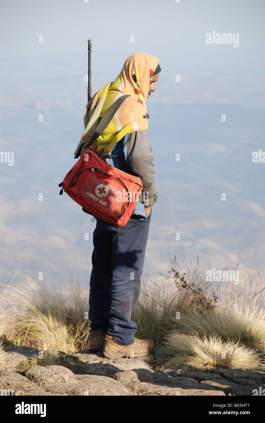 a scout from the Simien mountain park service in Ethiopia with a rifle and first aid bag - Stock Image
