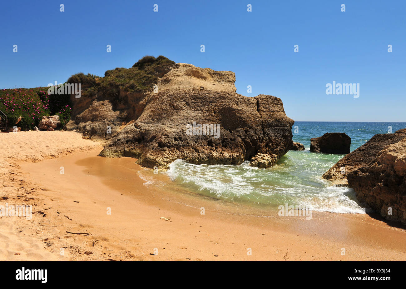 Rocky and sandy cove at Gale, Algarve, Portugal - Stock Image
