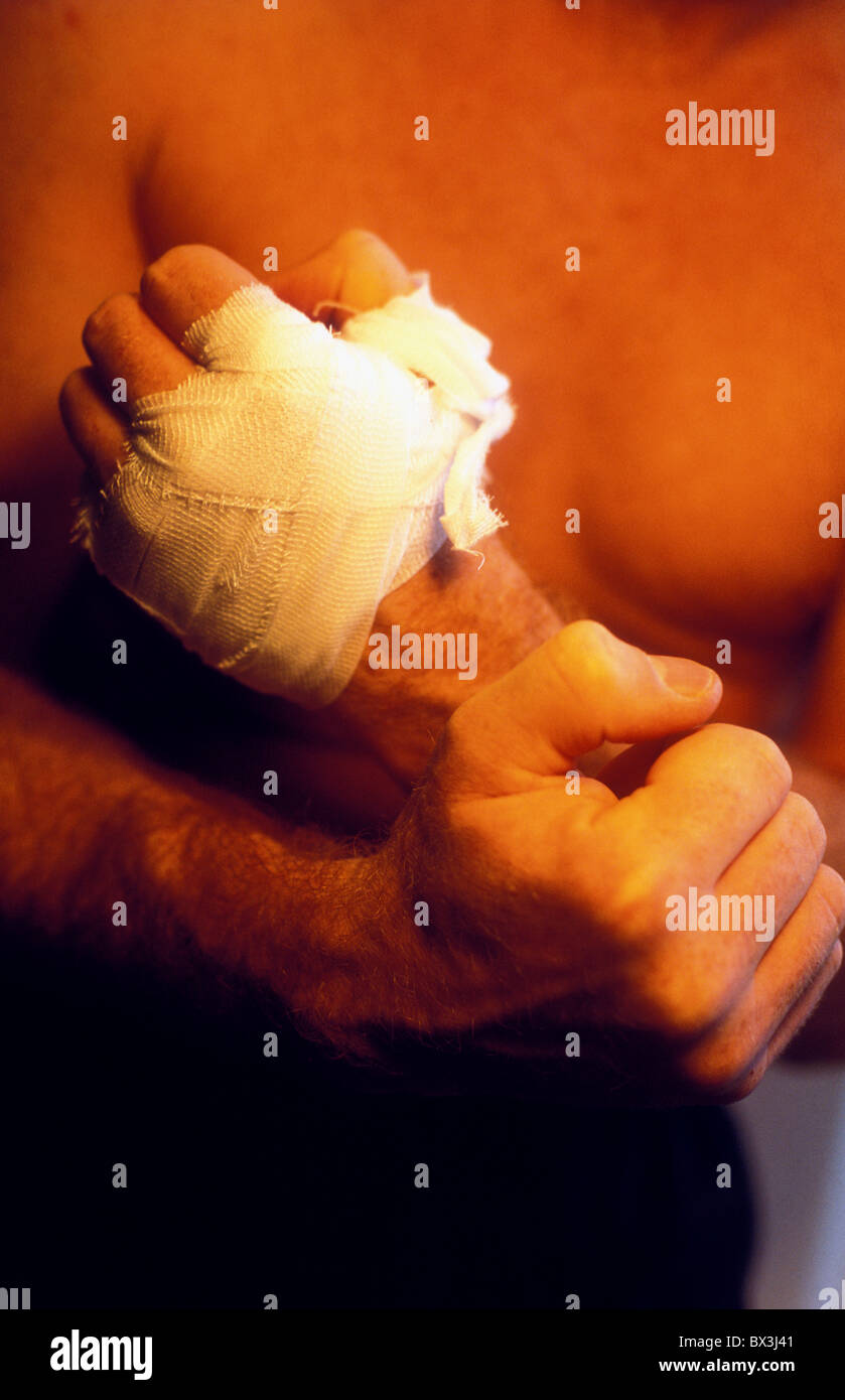 Hands of boxer strapped before bout - Stock Image