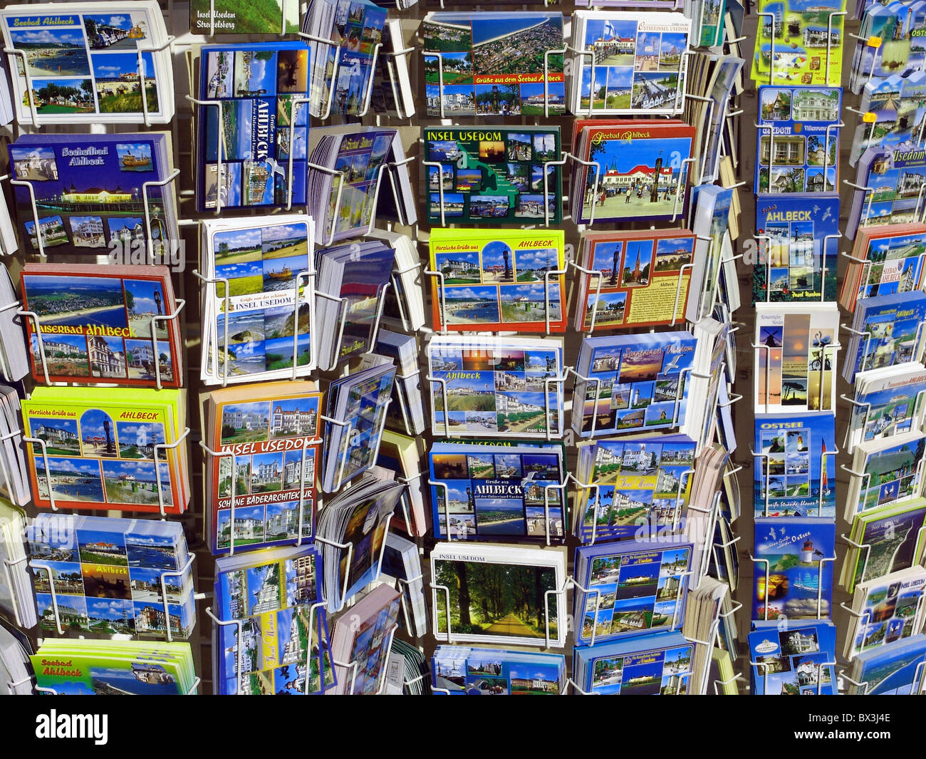 postcards postcards stands racks maps cards play cards souvenir tourism Usedom seaside resort Ahlbeck Balt - Stock Image