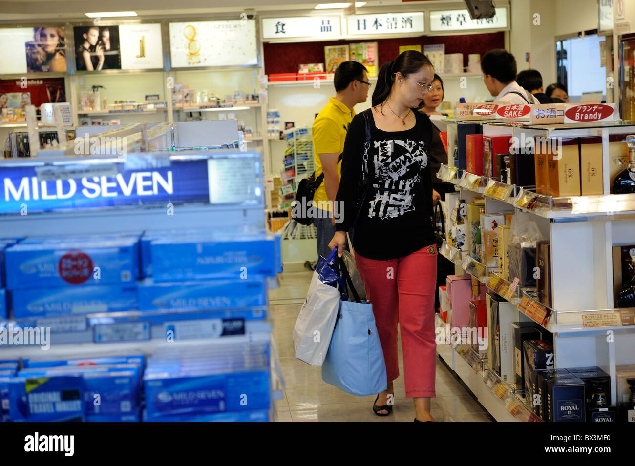 Chinese tourists shopping at duty free shop in Kansai international airport in Japan. 22-Sep-2010 - Stock Image
