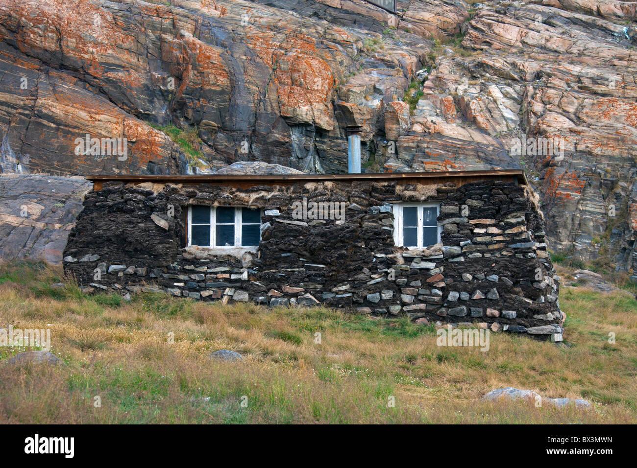 Qarmaq / qammaq, a traditional sod house at the Uummannaq Museum, North-Greenland, Greenland - Stock Image