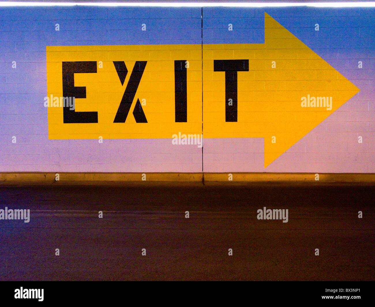 Exit sign in parking garage - Stock Image
