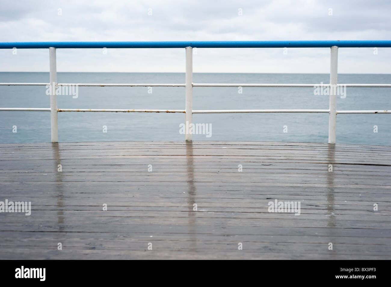 Handrail on a deck in the rainy day - Stock Image
