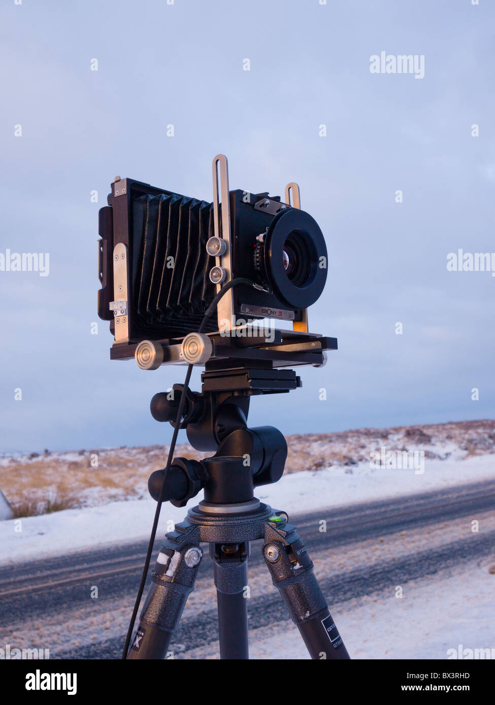 An Ebony RSW45 4x5 inch large format Field Camera being used to photograph a winter landscape. - Stock Image