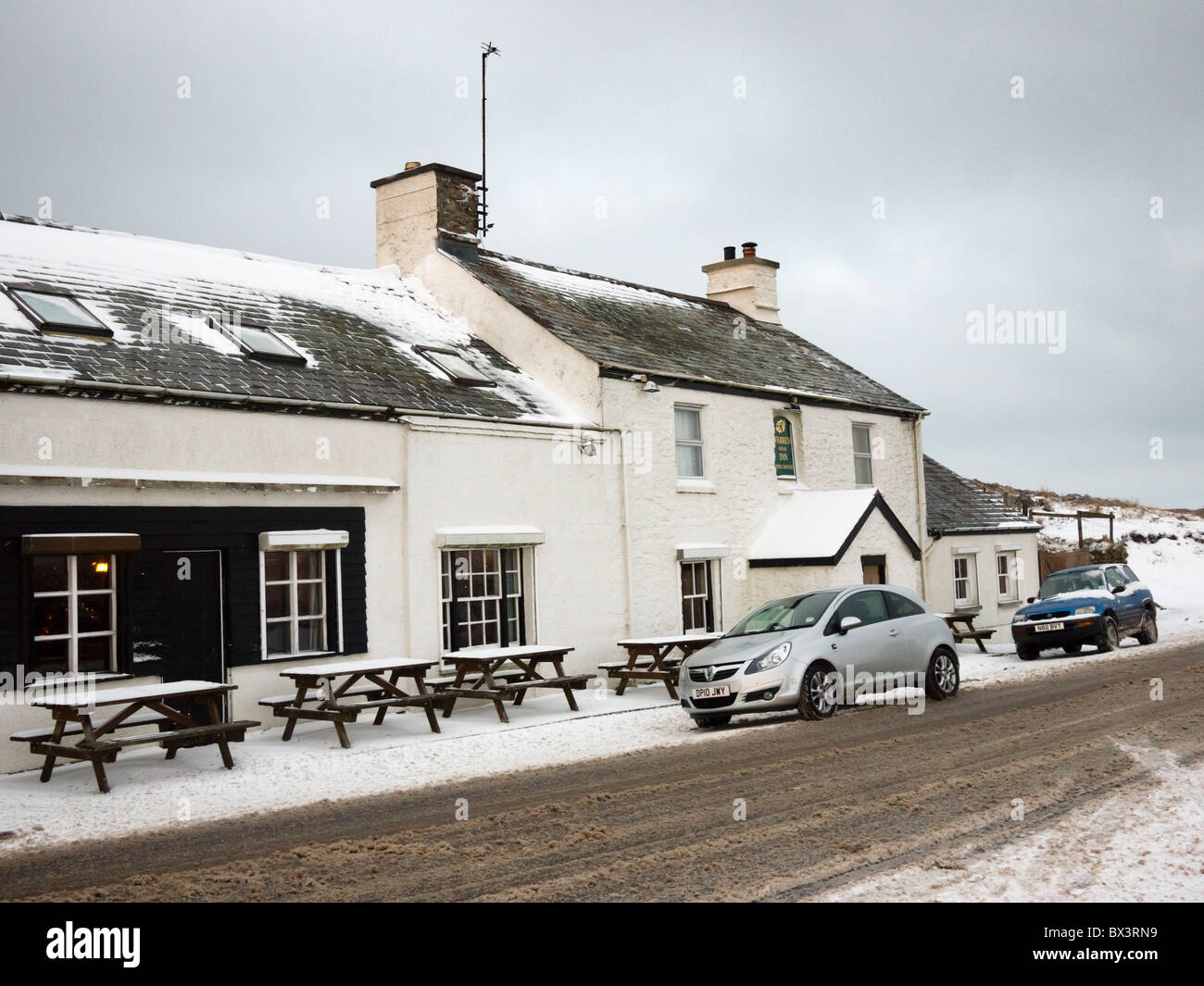 Warren House Inn in Dartmoor National Park in winter near Postbridge, Devon, England, United Kingdom. - Stock Image