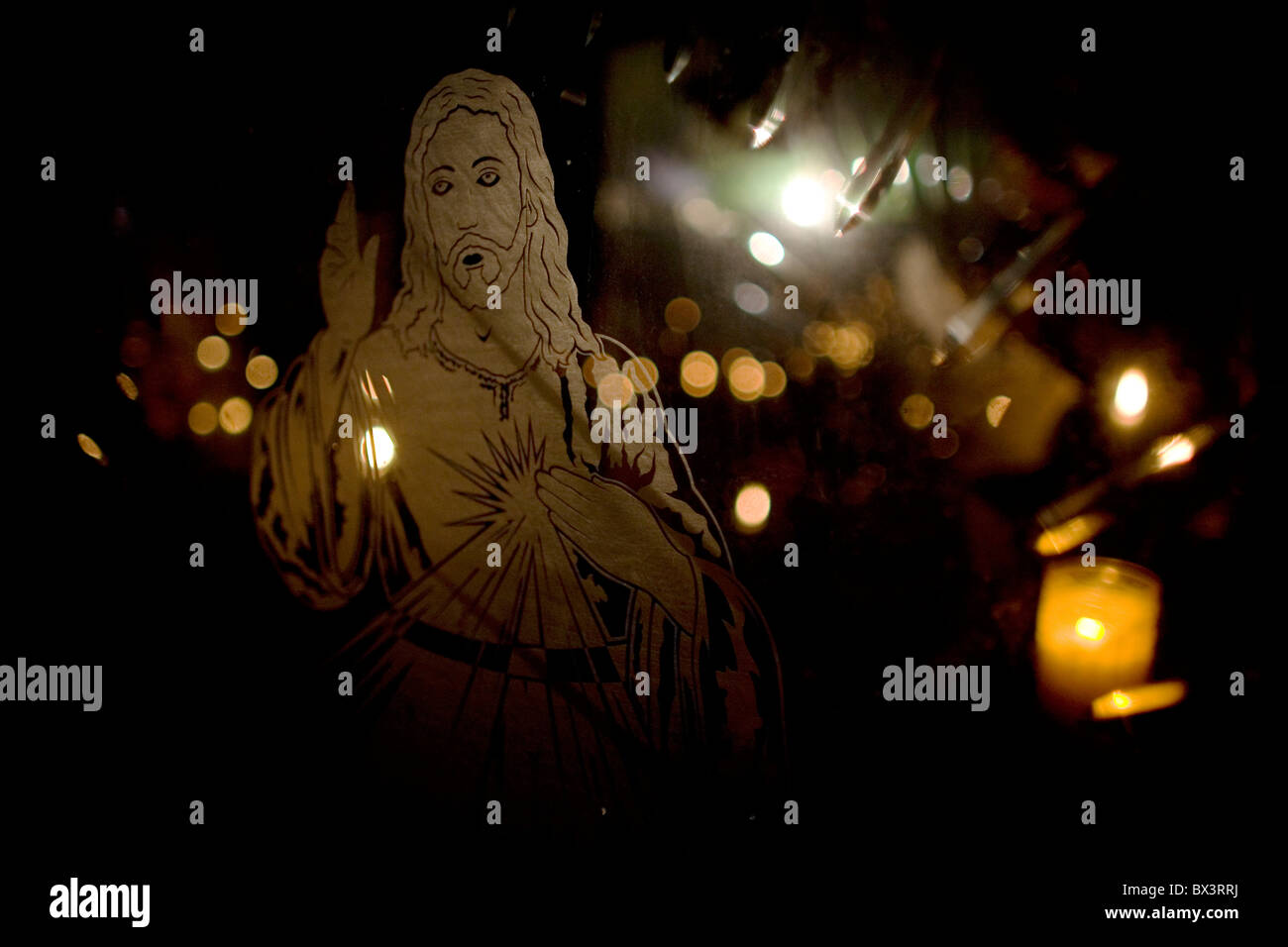 A transparency of Jesus Christ decorates the glass window of a tomb at the cemetery in Xochimilco, Mexico City - Stock Image