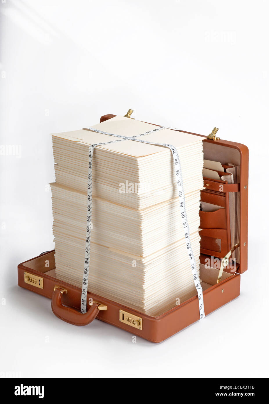 open briefcase with stacks of papers and measuring tape - Stock Image