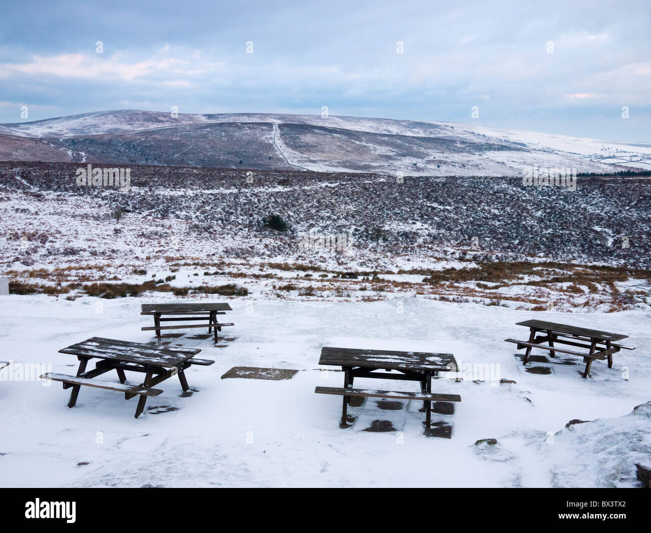 Tables outside the Warren House Inn in Dartmoor National Park overlooking Challacombe Down and Hameldown Tor near - Stock Image