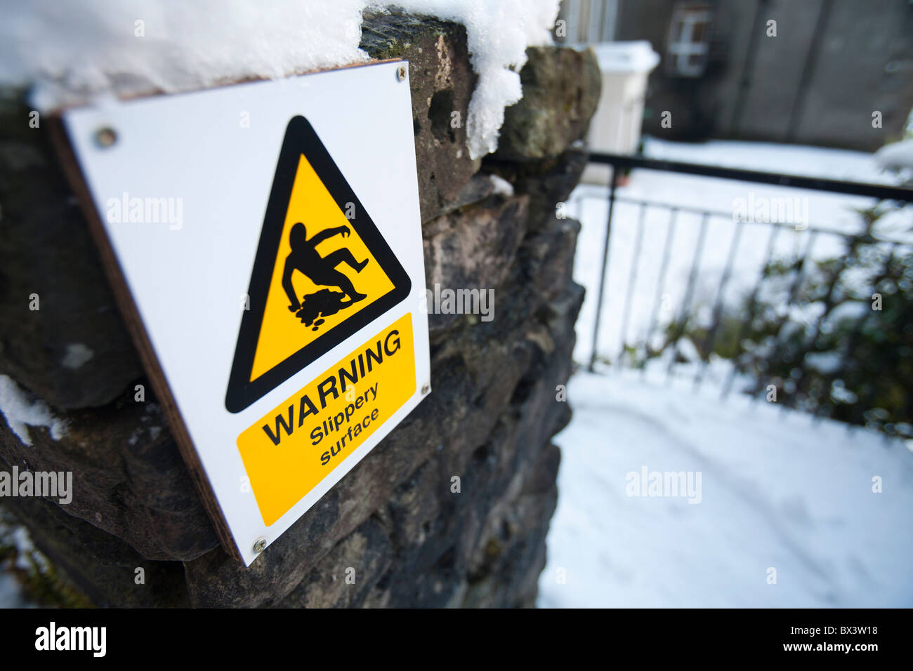 A slippery warning sign at Rydal Hall, Lake District, UK. - Stock Image