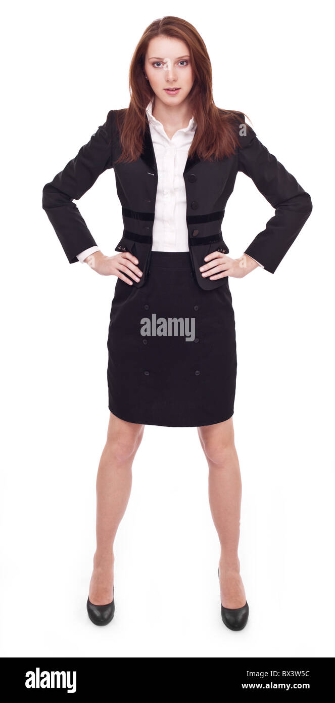 Portrait of business woman with arms a-kimbo. - Stock Image