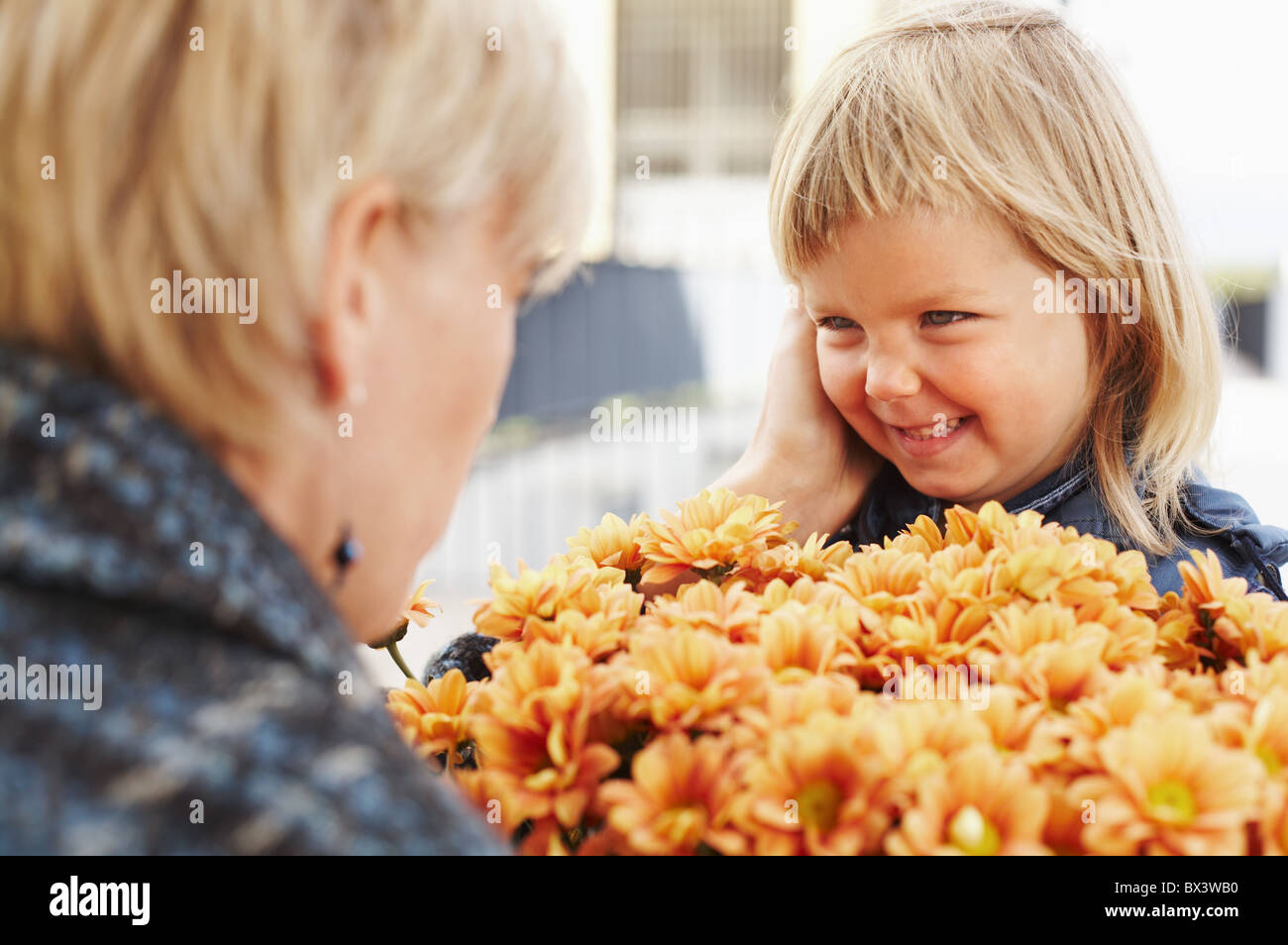 Woman with a little girl outdoors. - Stock Image