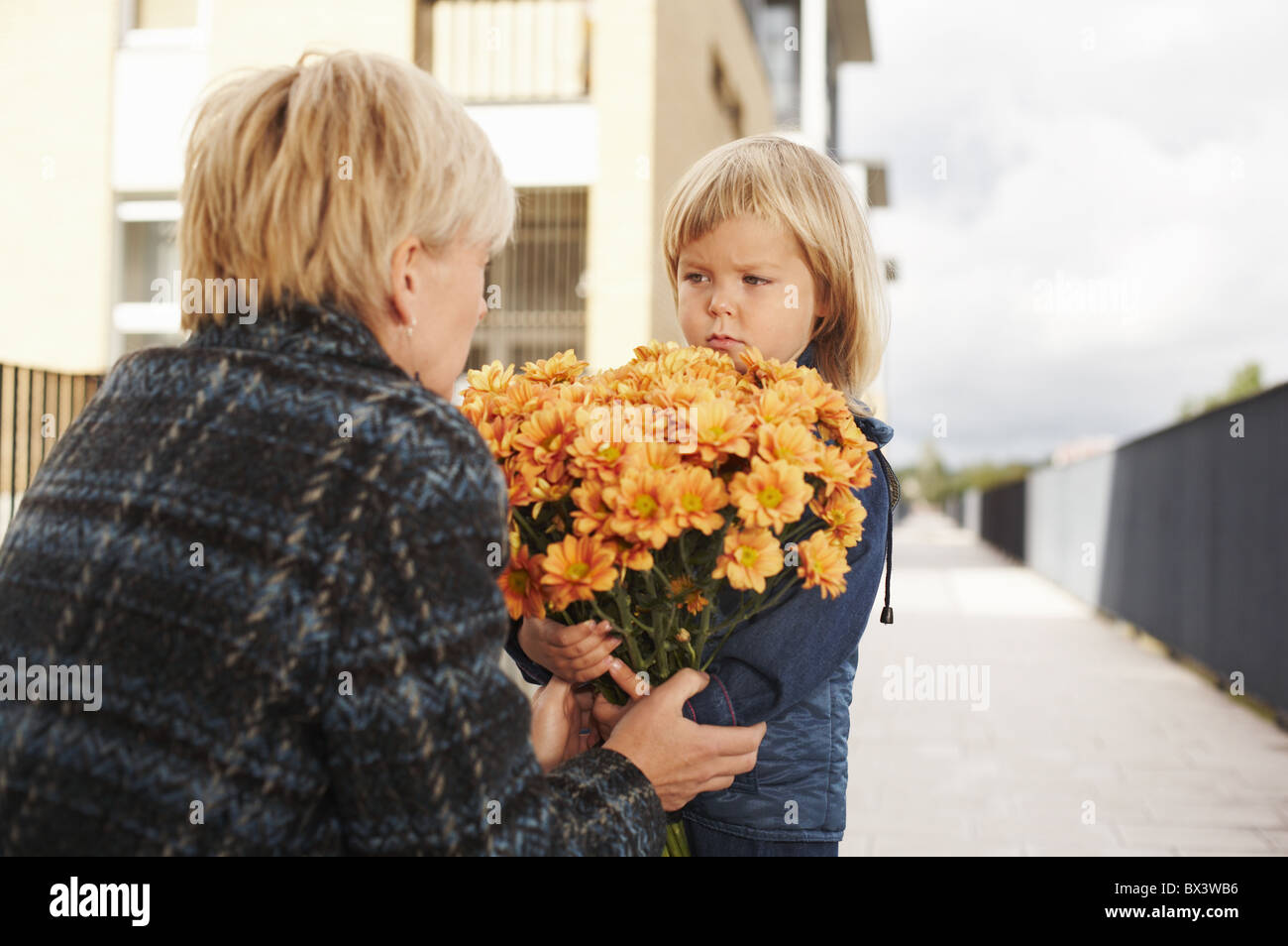 Woman with a little girl outdoor. - Stock Image