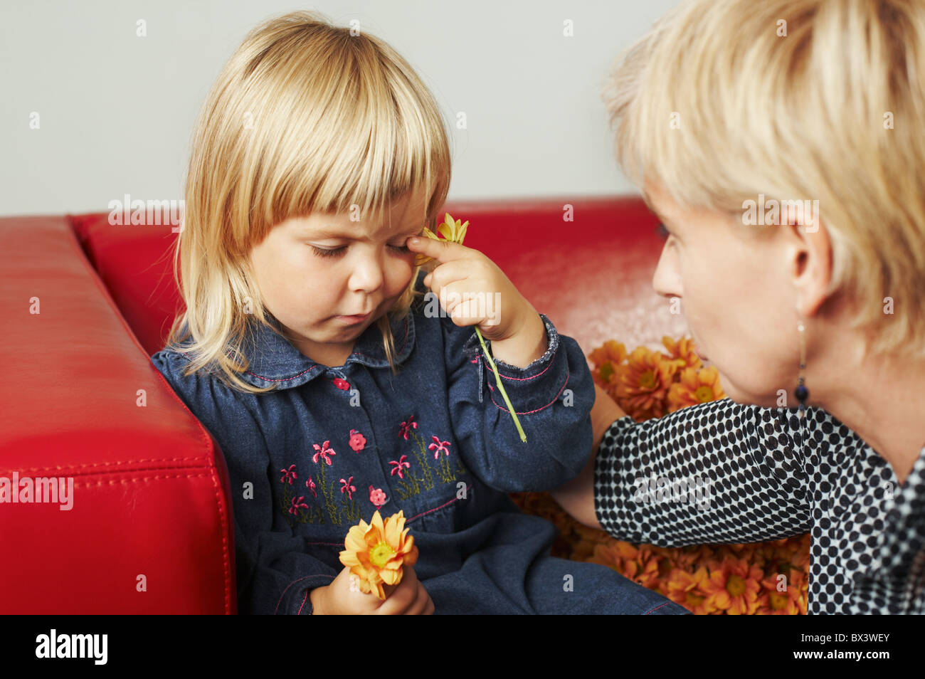 Woman with a little girl at home. - Stock Image