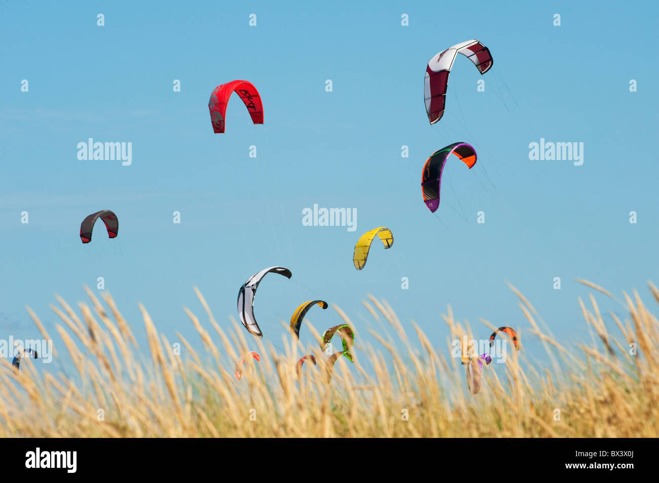 Kites Of Kite Surfers In Front Of Hotel Dos Mares; Tarifa, Cadiz, Andalusia, Spain - Stock Image
