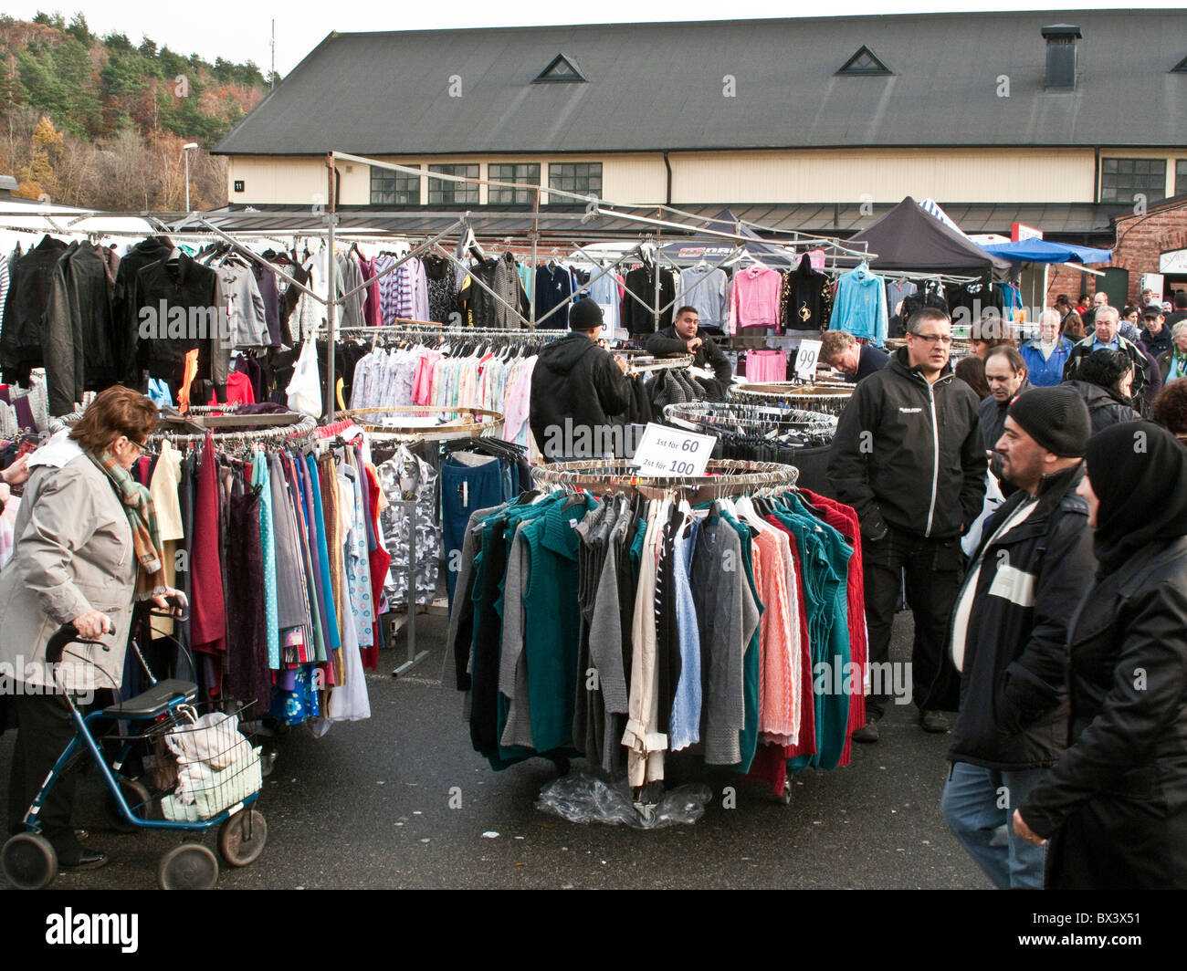 Cut-rate goods displayed at Kviberg flea market in outskirt of Gothenburg, Sweden. - Stock Image