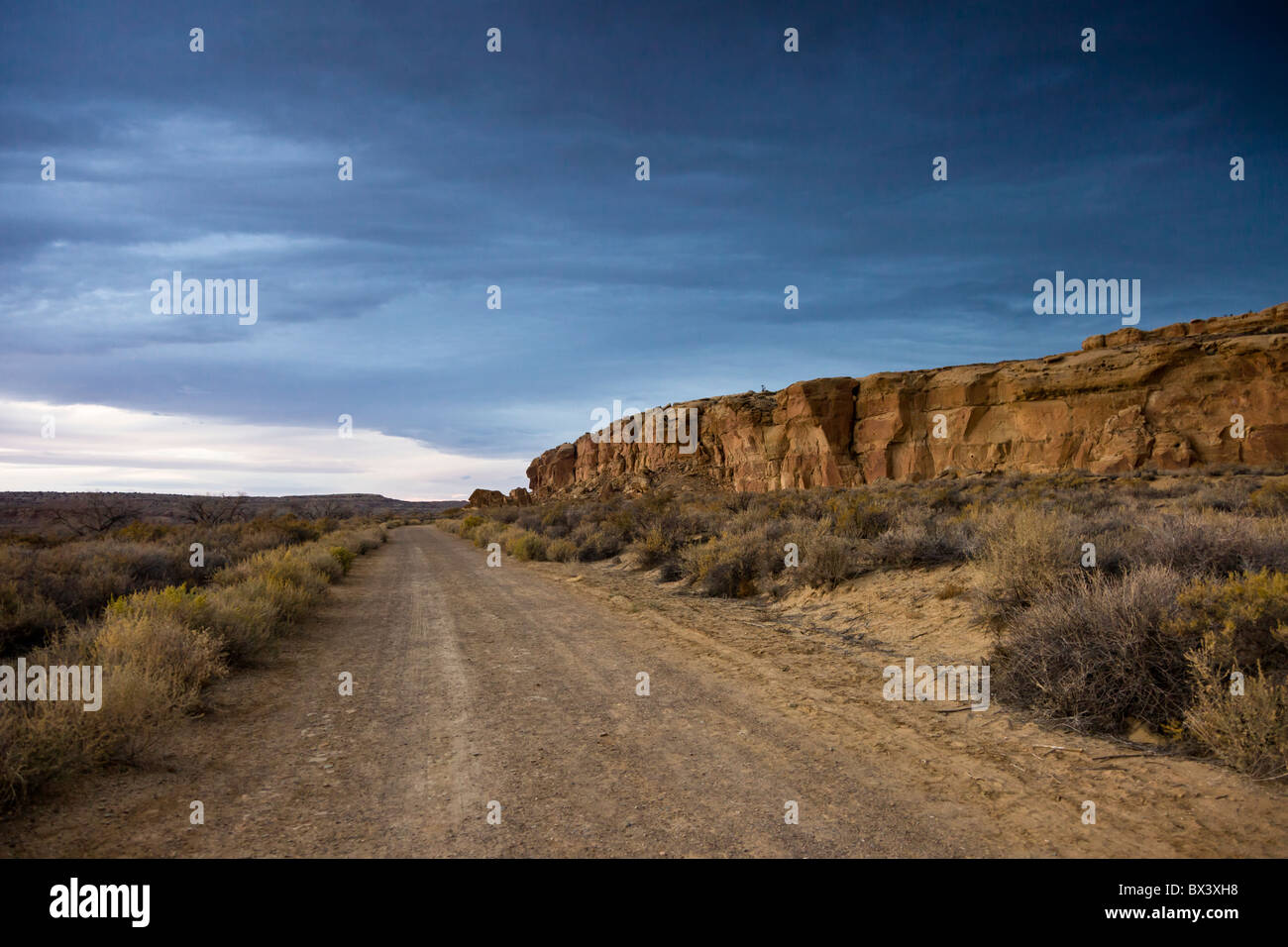 Desert road going through Chaco Canyon in the Chaco Culture National Historic Park in Chaco Canyon, New Mexico USA. - Stock Image