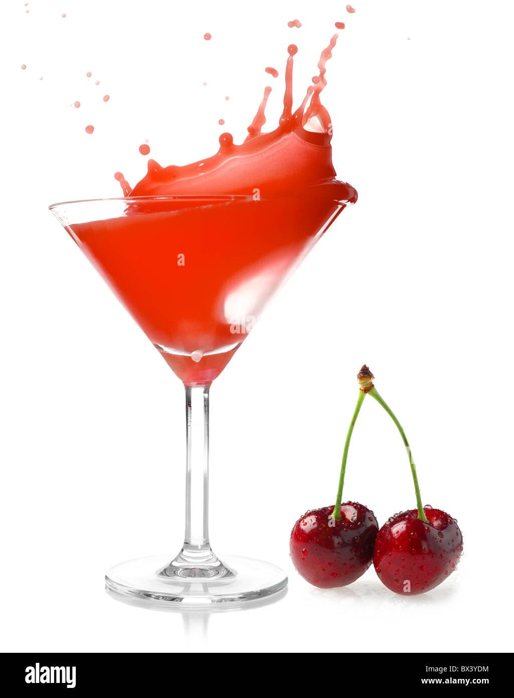 Cherry juice splash studio isolated on white background - Stock Image