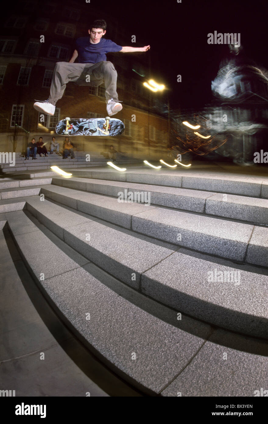 Skateboarder Toby Shuall does a frontside nollie flip in front of St Paul's Cathedral, London, United Kingdom - Stock Image