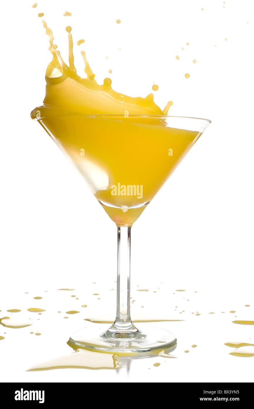 Orange juice splash studio isolated on white background - Stock Image